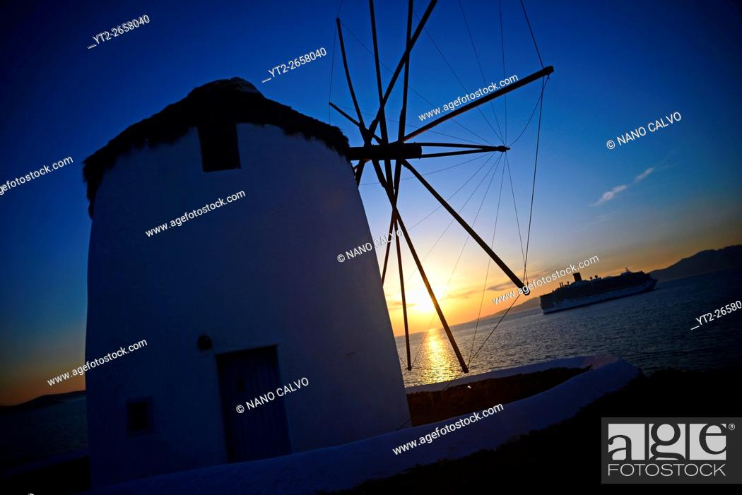 Stock Photo: Traditional windmills (Kato Milli) at sunset in Mykonos town, Greece.