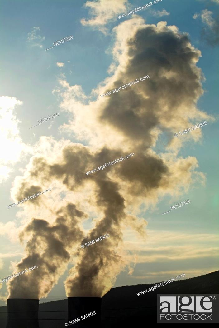 Stock Photo: Smoke emitting from cooling towers of Tricastin Nuclear Power Plant, Drome, France.