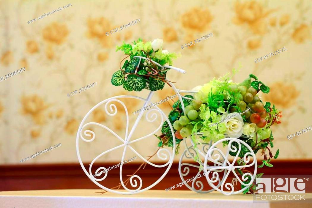 Stock Photo: Fake flower on a bicycle.