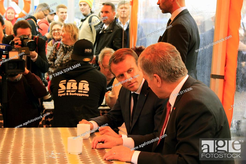 Stock Photo: Helsinki, Finland. August 30, 2018. French President Emmanuel Macron (C) and Finnish President Sauli Niinistö (R) have a cup of coffee at Market Square.