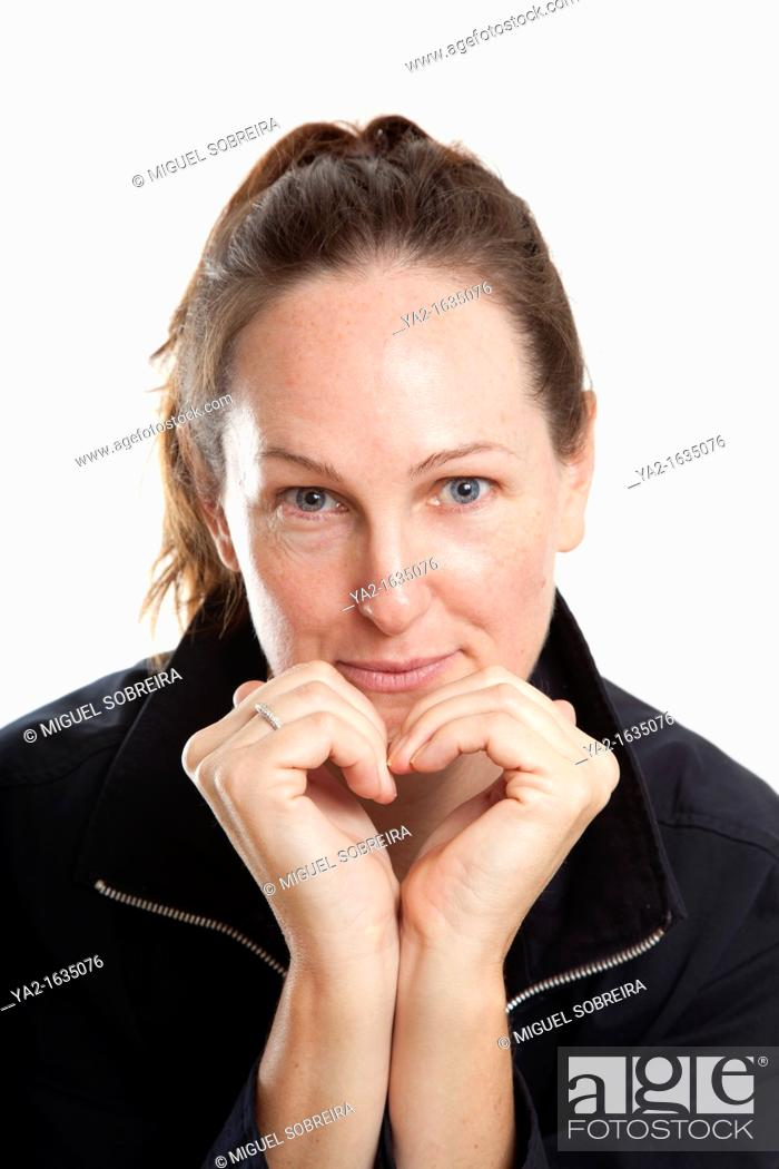 Stock Photo: Woman making heart shape with hands.