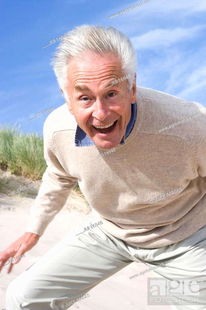 Stock Photo: Portrait of senior man shouting on beach.