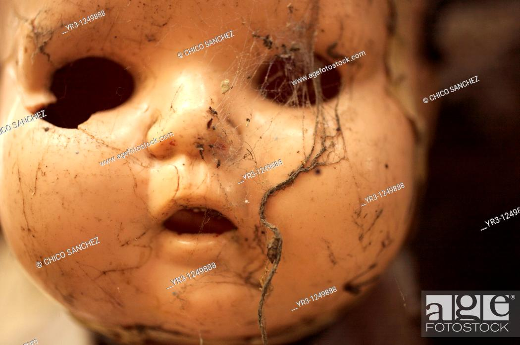 Stock Photo: A doll covered with spider web hangs on a tree on the Island of the Dolls in Xochimilco, southern Mexico City. The late Don Julian turned his 'chinampa.