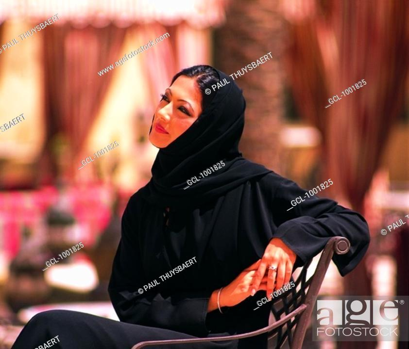 Stock Photo: Arab Woman sitting on a chair outdoors.