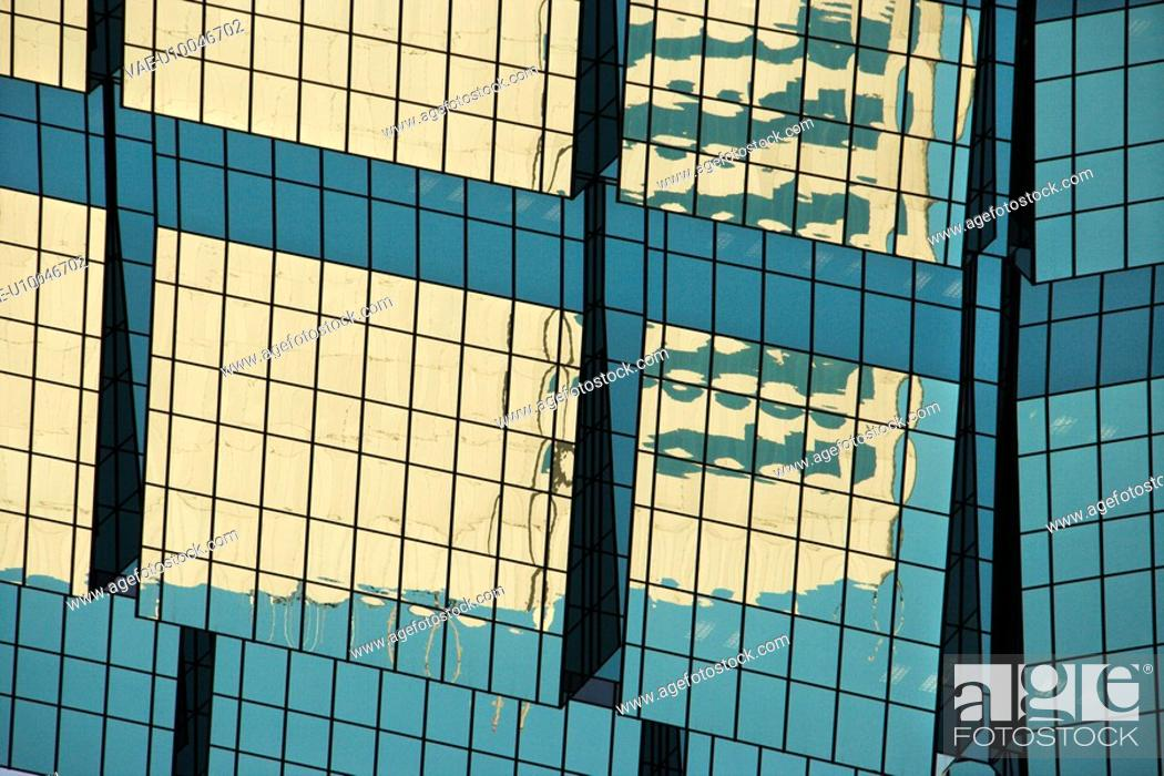 Stock Photo: Abstract cose-up of side of urban building reflecting sunlight.
