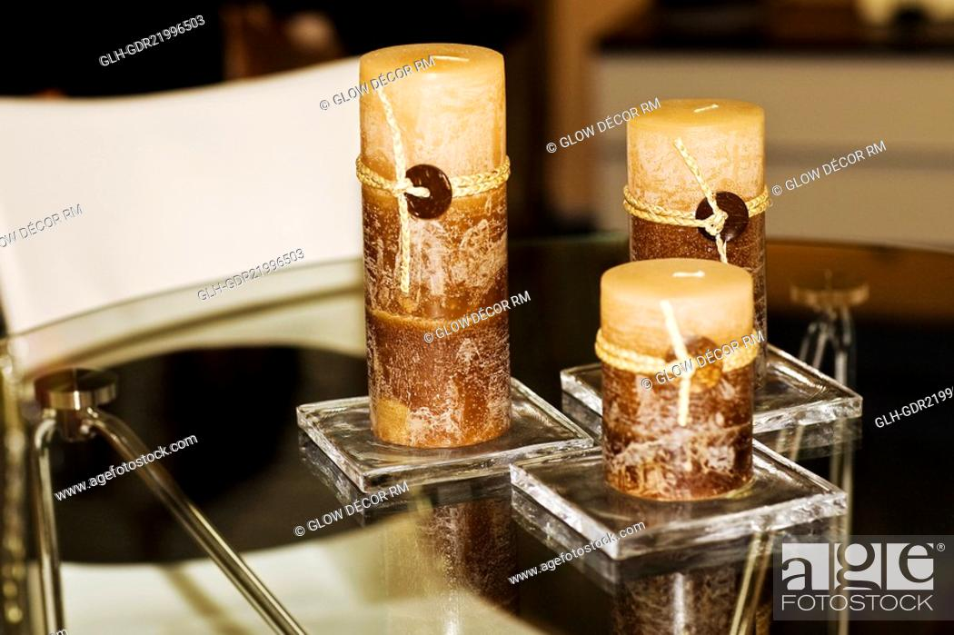 Photo de stock: Close-up of candles on a dining table.