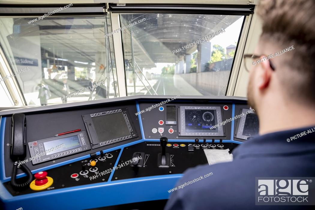 Stock Photo: 23 May 2019, North Rhine-Westphalia, Cologne: A locomotive driver sits in the driver's cab of the locomotive of the first train of the FlixTrain connection.