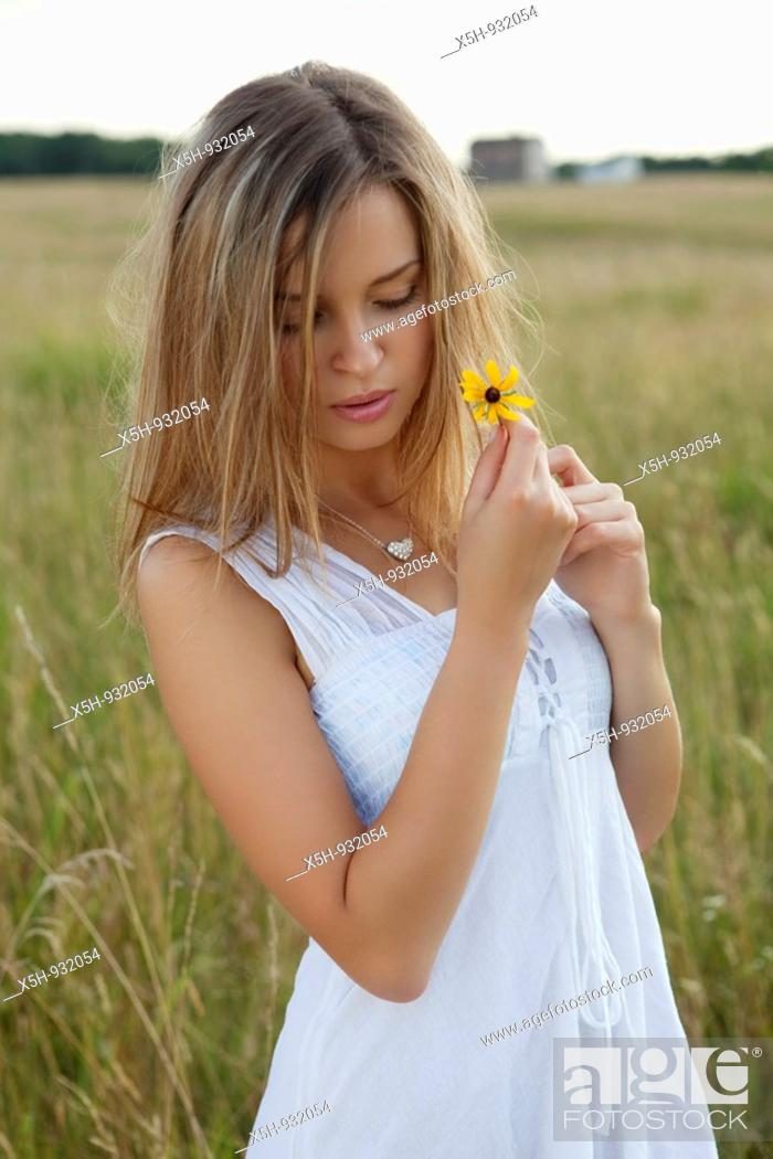 Stock Photo: one young woman with flower.