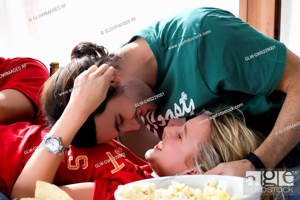 Stock Photo: Close-up of a young couple romancing.