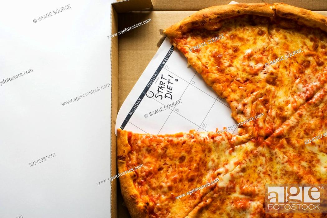 Stock Photo: A pizza and a calendar saying start diet.