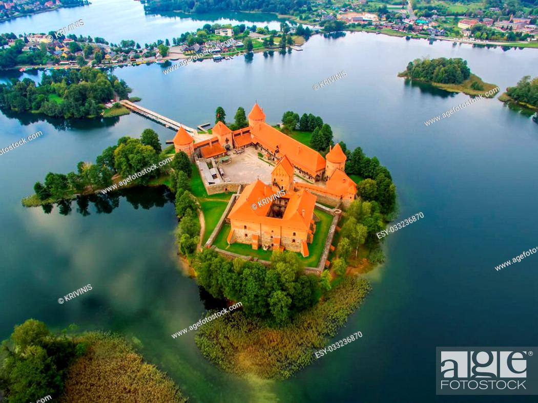 Stock Photo: Trakai, Lithuania: aerial UAV top view of Island Castle in the sunrise. Historical residence in capital city of Grand Duchy of Lithuania, located in Galve lake.