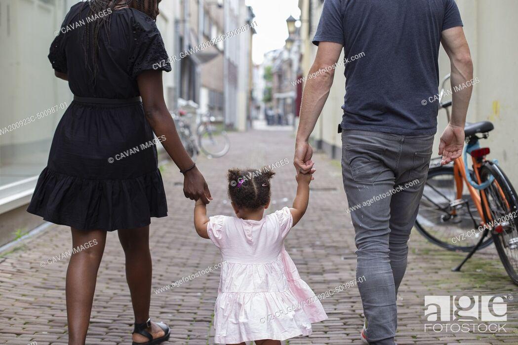 Stock Photo: An interracial family walking in a Dutch city.