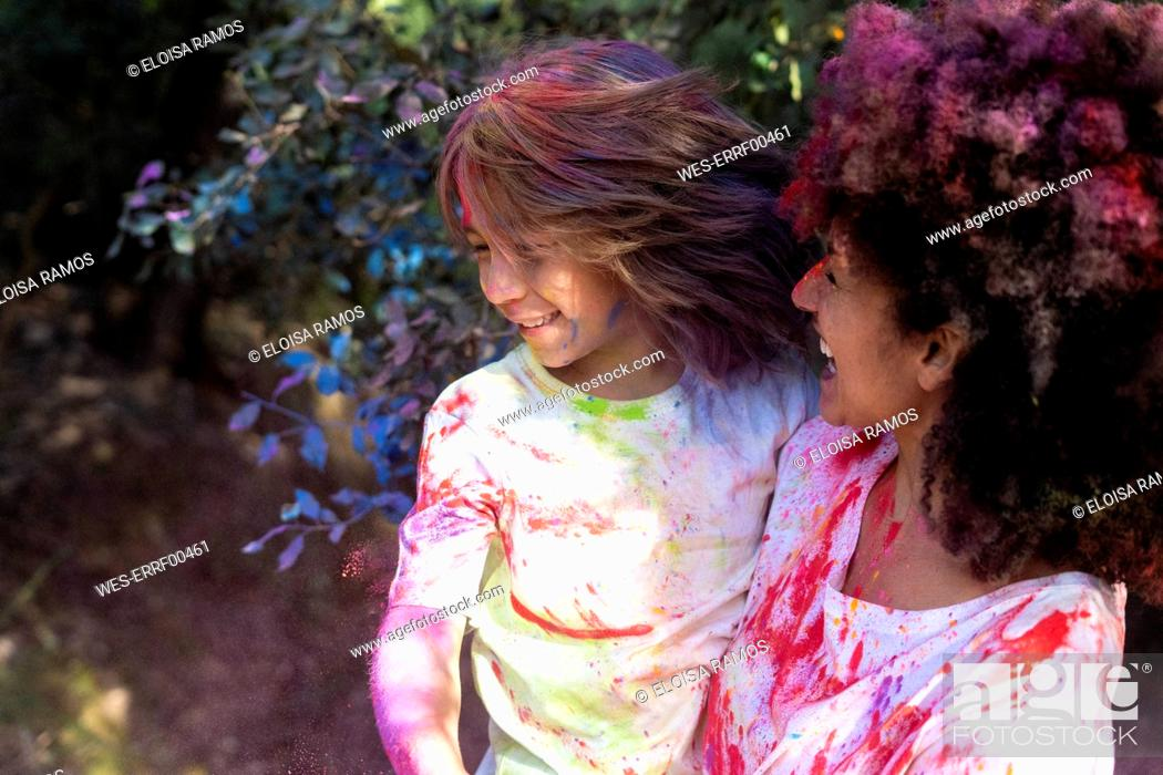 Stock Photo: Mother and son full of colorful powder paint, celebrating Holi, Festival of Colors.