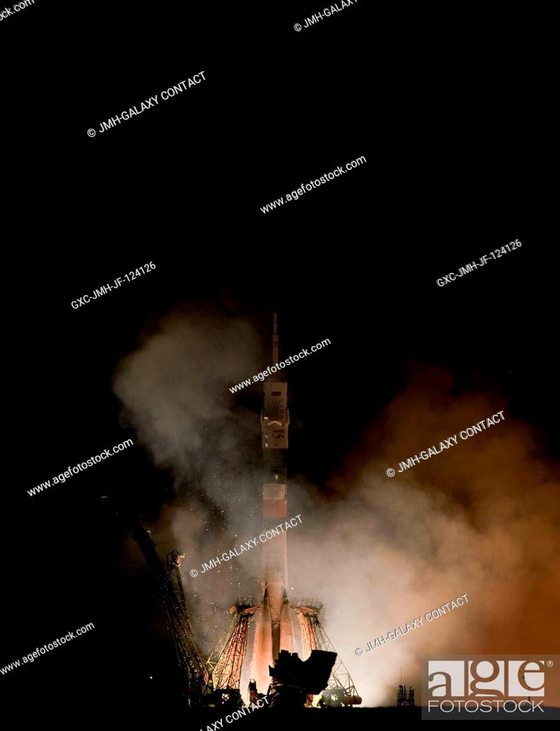 Stock Photo: The Soyuz TMA-19 rocket launches from the Baikonur Cosmodrome in Kazakhstan carrying Expedition 24 NASA crew members -- NASA astronauts Shannon Walker and.