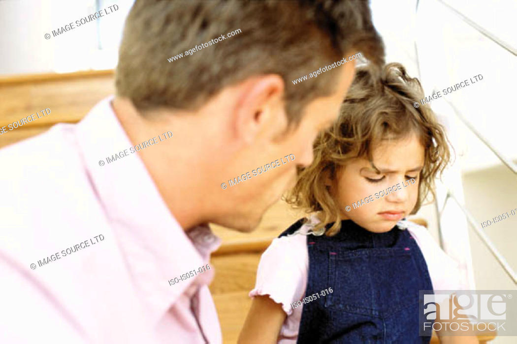 Stock Photo: Father telling off naughty daughter.