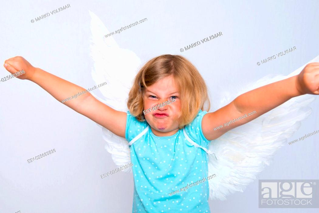 Stock Photo: wild blond girl with angel- wings in front of white background.
