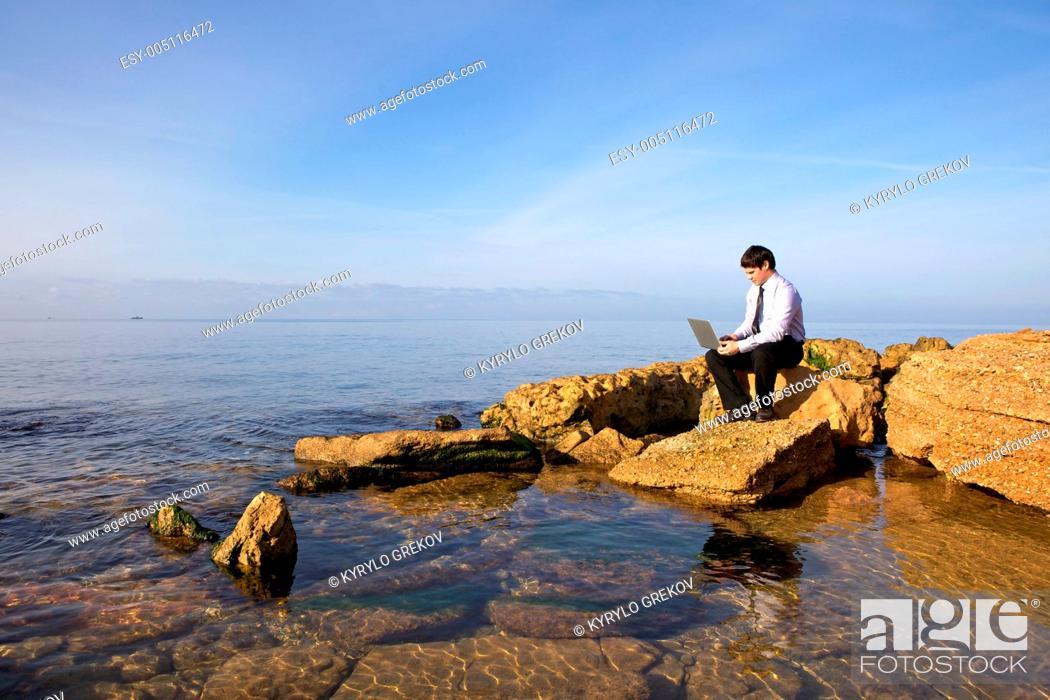 Stock Photo: Man with laptop.