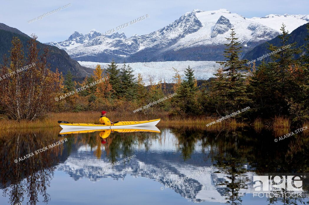 Stock Photo: Person in sea kayak in a lake near Mendenhall Glacier, Tongass National Forest, Juneau, Southeast Alaska, Autumn.