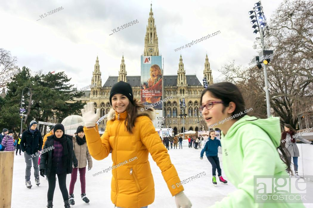 Stock Photo: Vienna, Austria, Austrian Teenagers Ice Skating in Front of City Hall Building, Rathaus, .