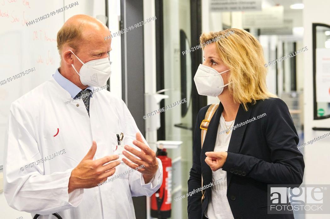 Stock Photo: 22 June 2021, Berlin: Stephan Eggeling, head physician at Vivantes Klinikum, talks with Daniela Ludwig (CSU), the German government's drug commissioner.