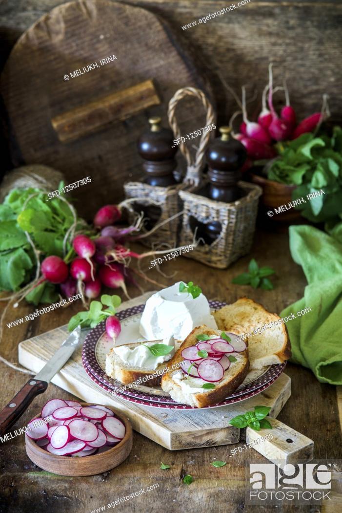 Stock Photo: Radish and goat cheese sandwich.