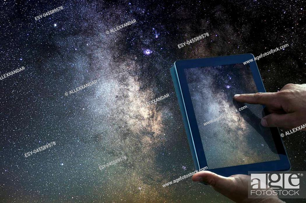 Stock Photo: Space Astronomy Exploration Concept. Night Sky tablet Milky Way Galaxy.