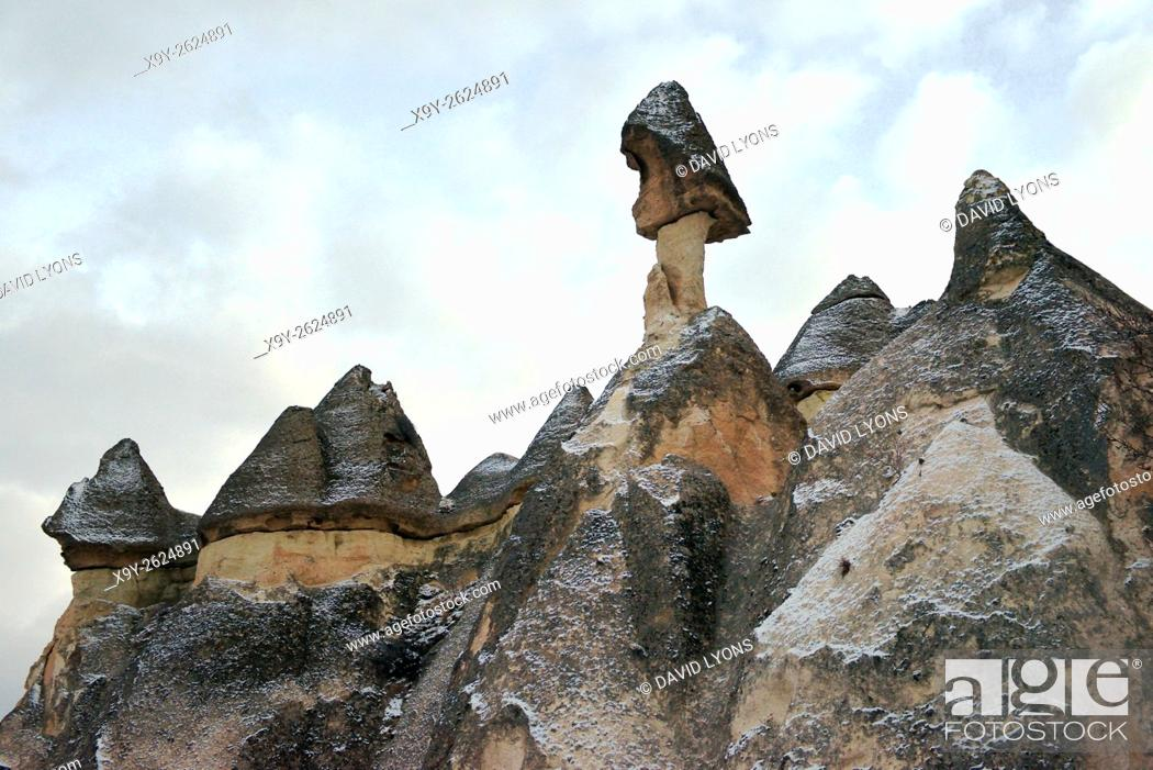Stock Photo: Eroded volcanic tuff rock pillars fairy chimneys in the Monks Valley Pasabagi area of Goreme National Park, Cappadocia, Turkey.