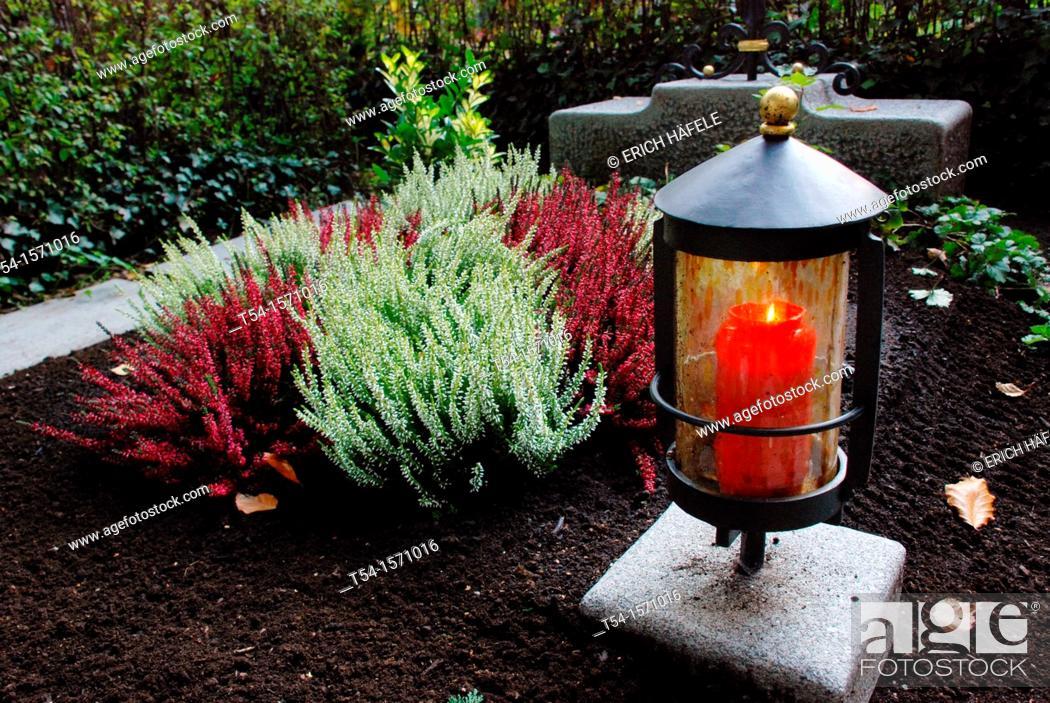 Stock Photo: Burning light grave on All Saints.