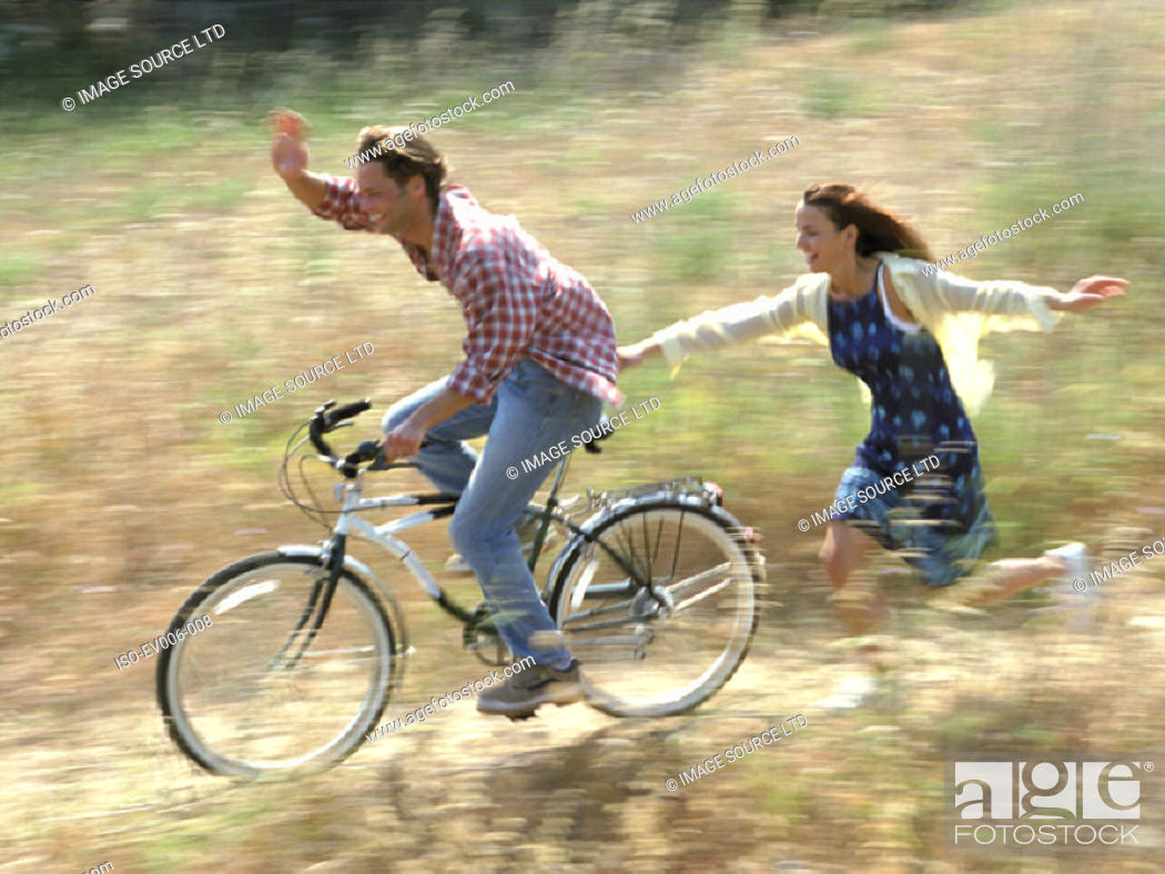 Stock Photo: Couple cycling.