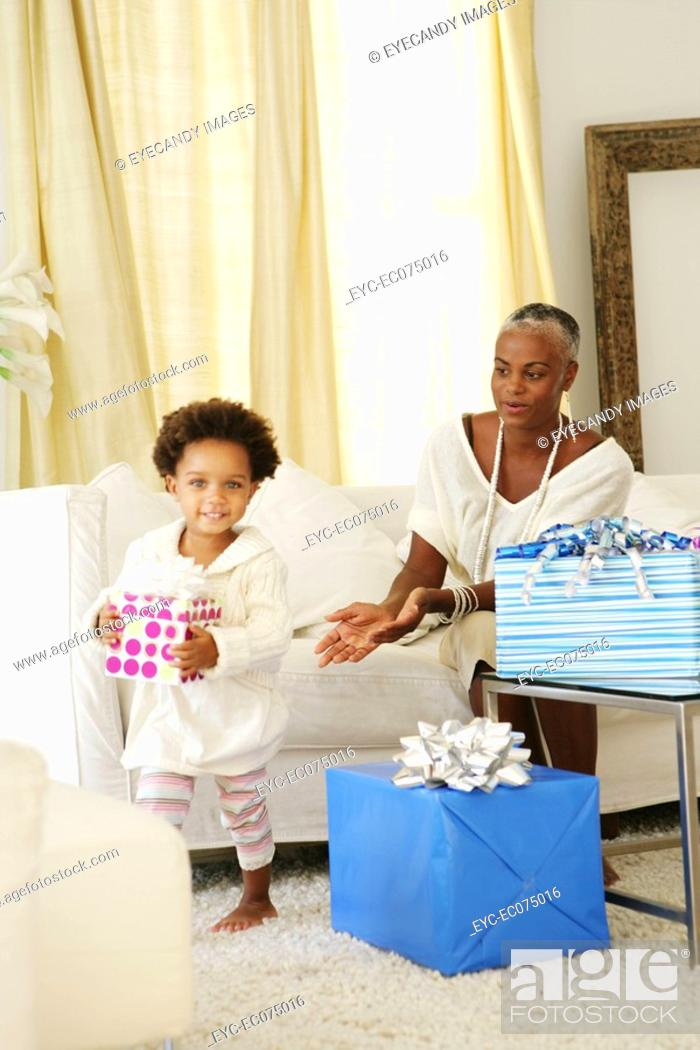 Stock Photo: African American mother and child at birthday party.