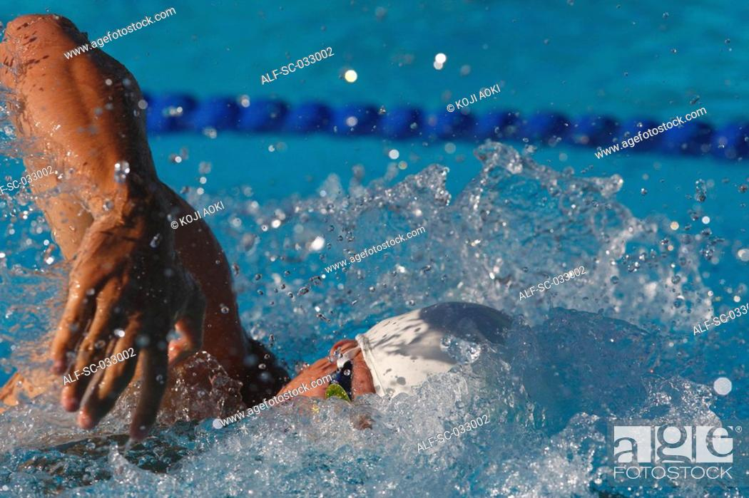 Stock Photo: Australian swimmer doing front crawl swimming stroke.