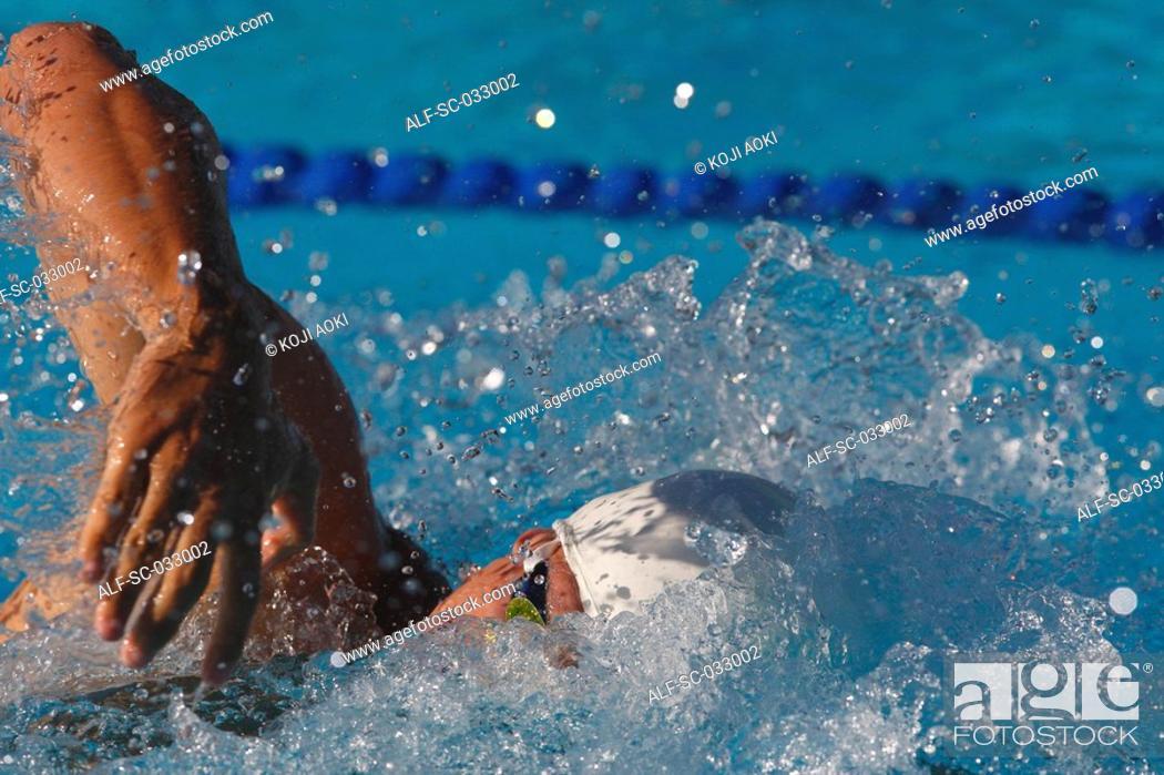 Stock Photo: Australian swimmer doing front crawl swimming stroke.