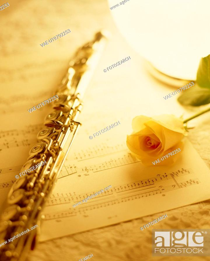 Stock Photo: A Score, A Flute, And A Rose.