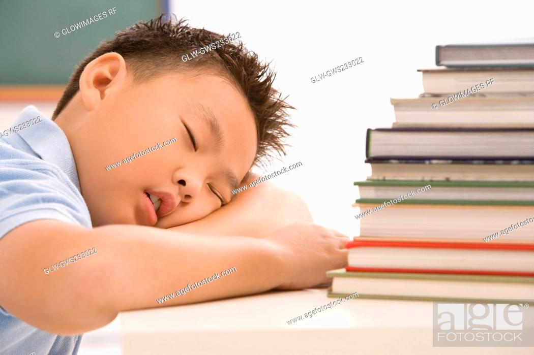 Stock Photo: Close-up of a schoolboy napping in a classroom.