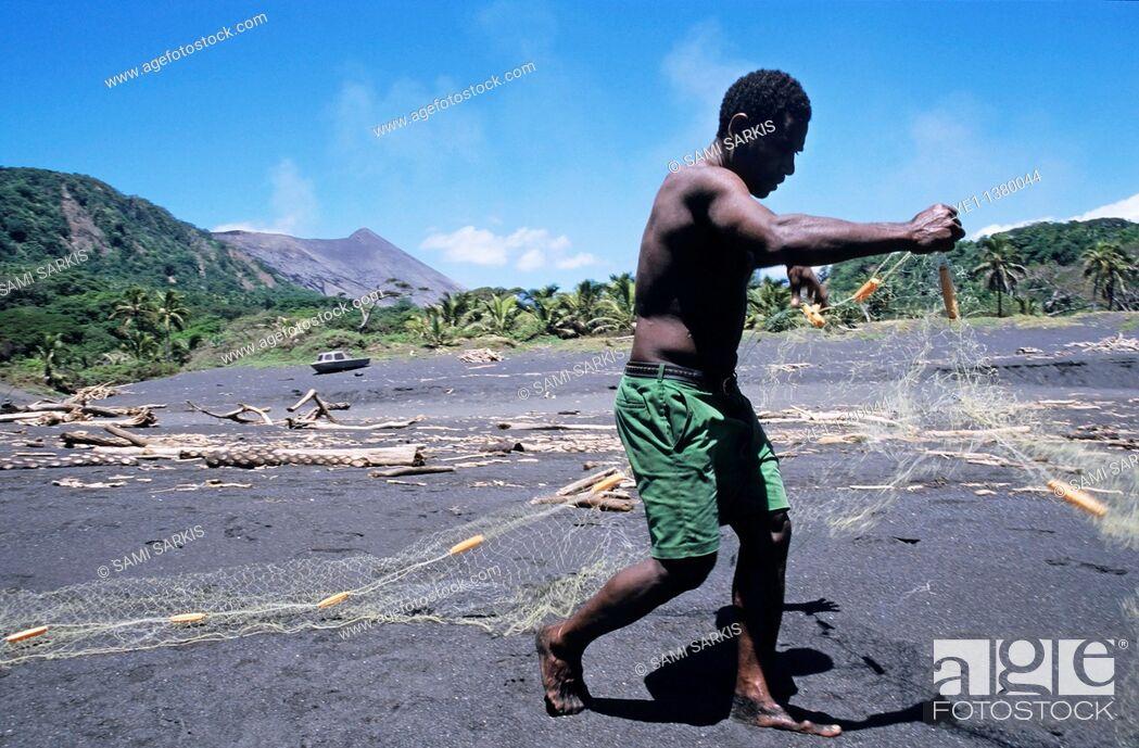 Stock Photo: Fisherman on a black sand beach preparing his nets, Sulphur Bay Village, Tanna Island, Vanuatu.