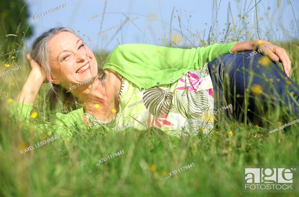 Stock Photo: woman relaxing on meadow.