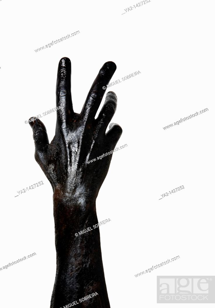 Stock Photo: Black painted hand and arm.