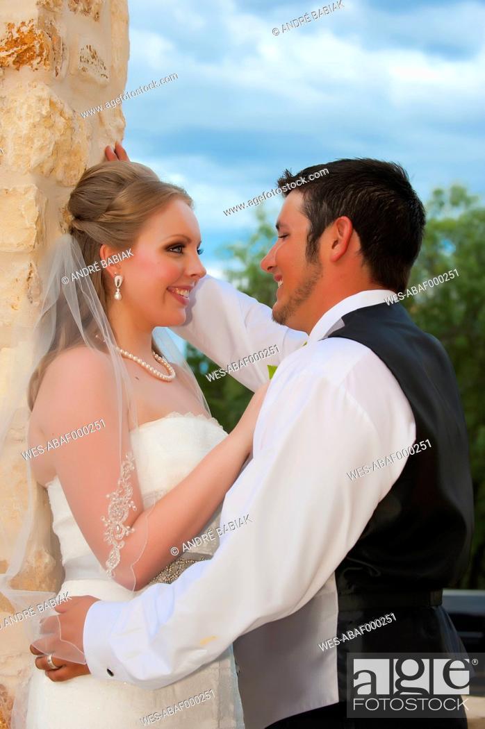Stock Photo: USA, Texas, Bride and groom romancing, close up.