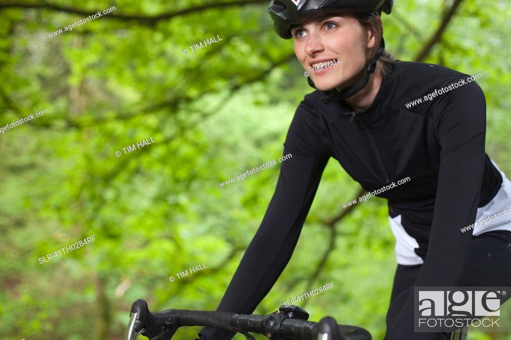 Stock Photo: Cyclist biking in park.