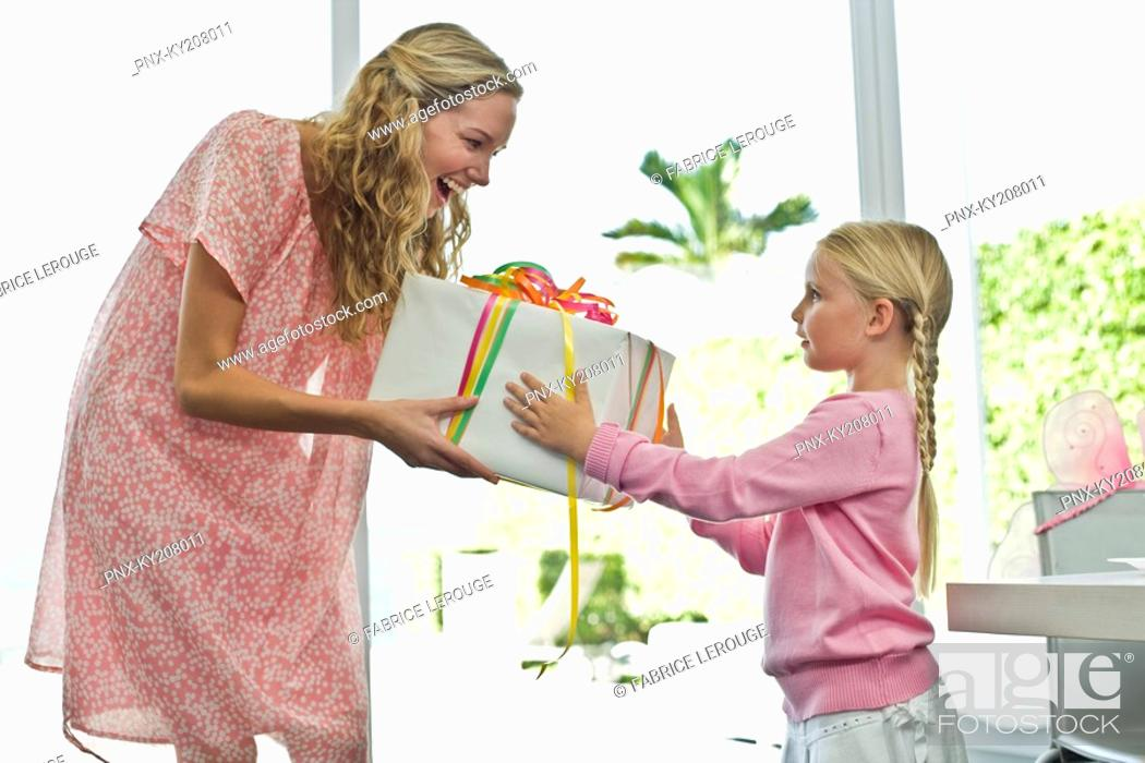 Stock Photo: Girl giving present to her mother.