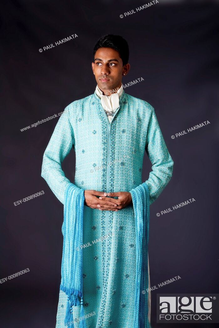Stock Photo: Beautiful authentic Indian hindu man in typical ethnic groom attire standing with hands together  Bangali male wearing a light blue agua decorated Dhoti with.
