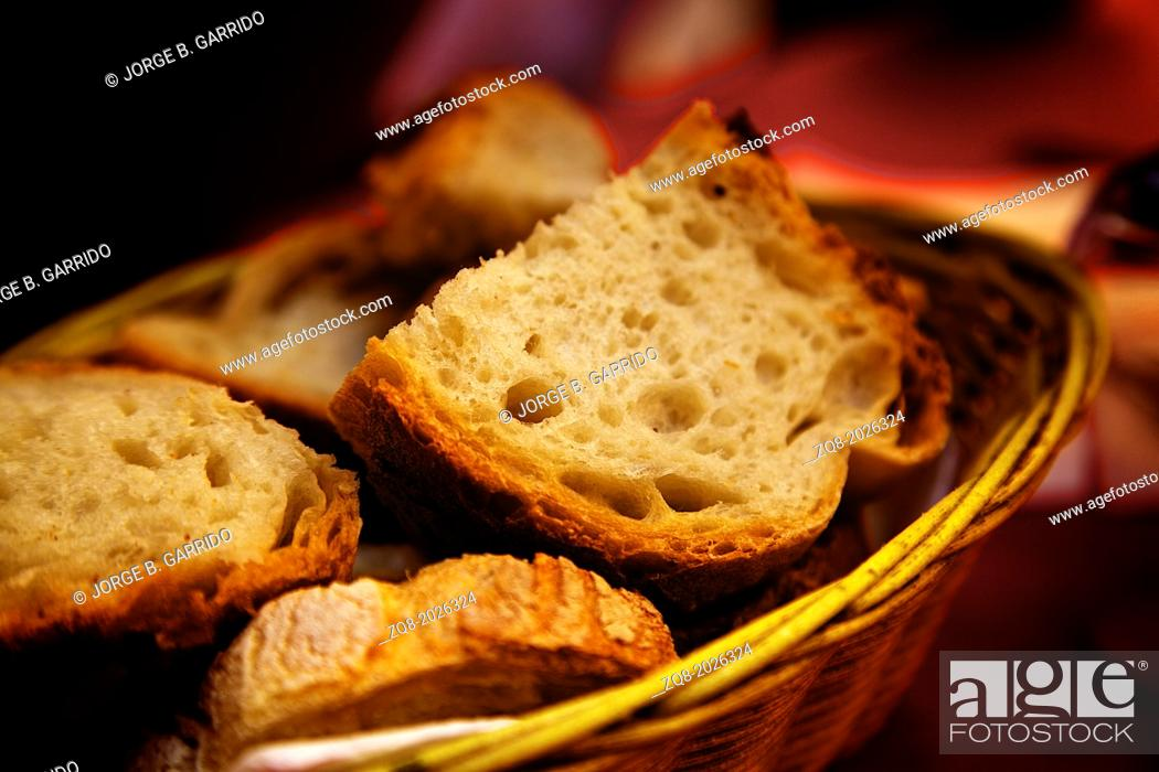 Stock Photo: assortment of baked bread on wood table.
