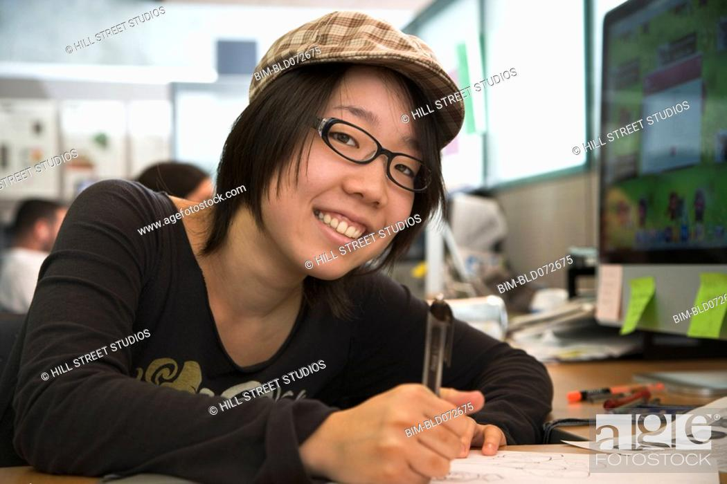 Stock Photo: Japanese college student working in classroom.