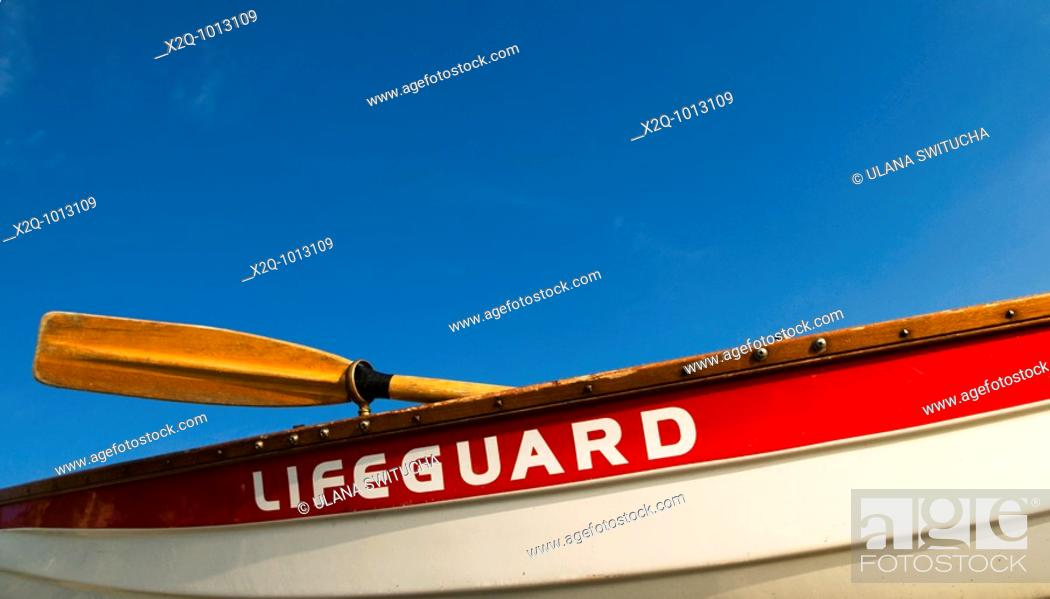 Stock Photo: A traditional red and white lifeboat.