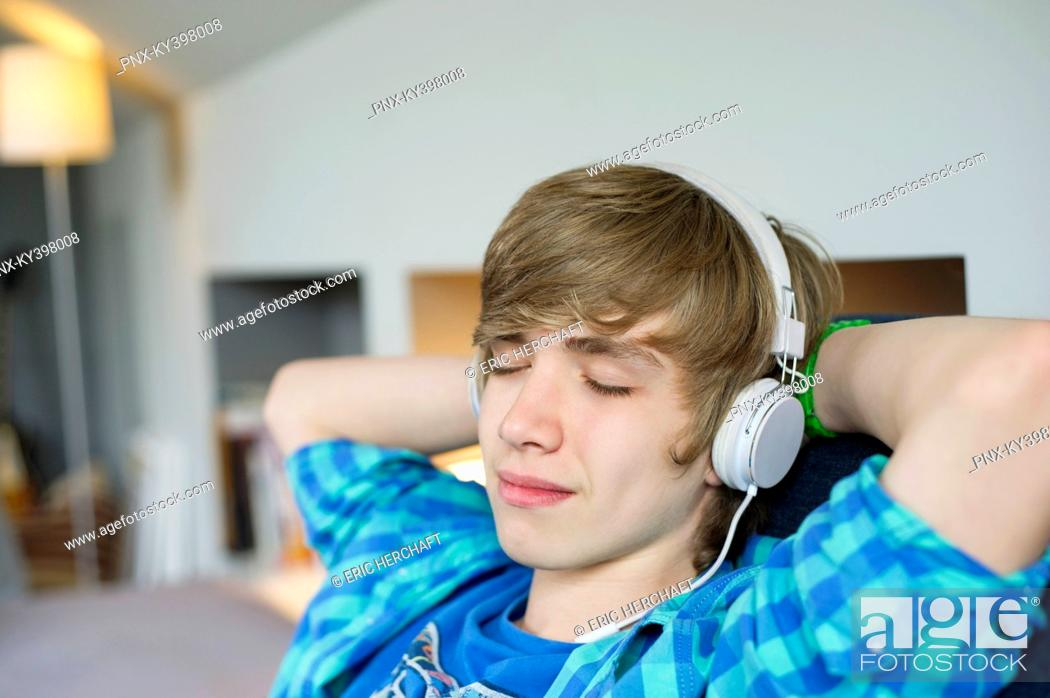Stock Photo: Teenage boy listening to music.