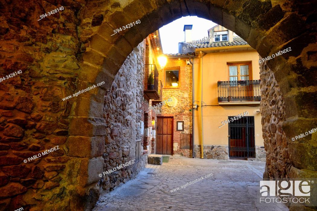Stock Photo: Passageway in the old town of Buitrago del Lozoya, Madrid, Spain.