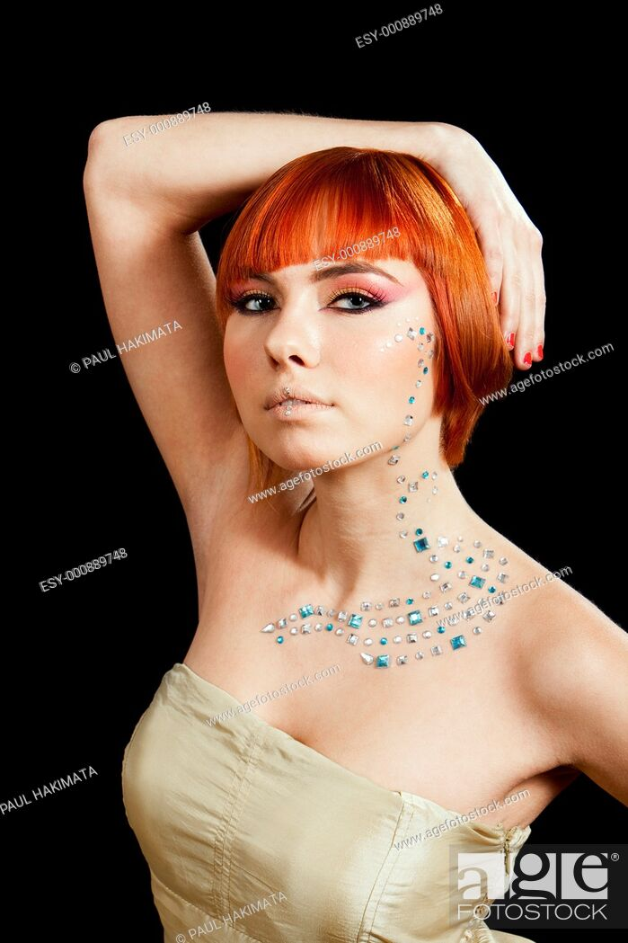 Stock Photo: Beautiful face of a redhead Caucasian girl with rhinestones and hand over her head, isolated.