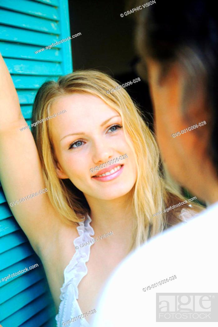 Stock Photo: Young woman looking at a man.