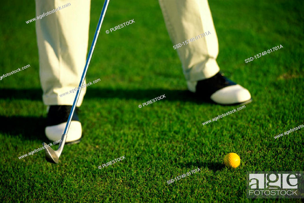 Stock Photo: Low section view of a person playing golf.