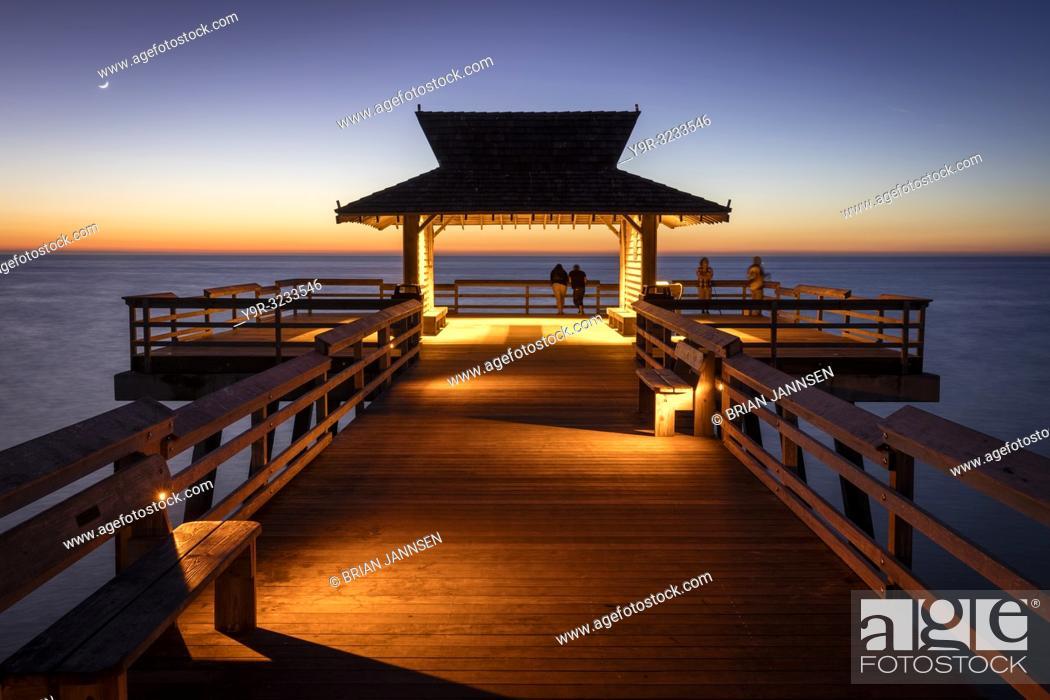 Stock Photo: Twilight view on Naples Pier overlooking the Gulf of Mexico, Naples, Florida, USA.